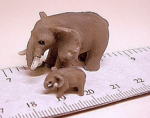 hand carved wood micro miniature elephant with baby