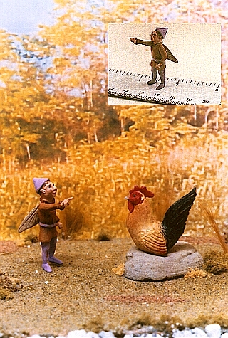 hand carved wood miniature boy fairy with rooster
