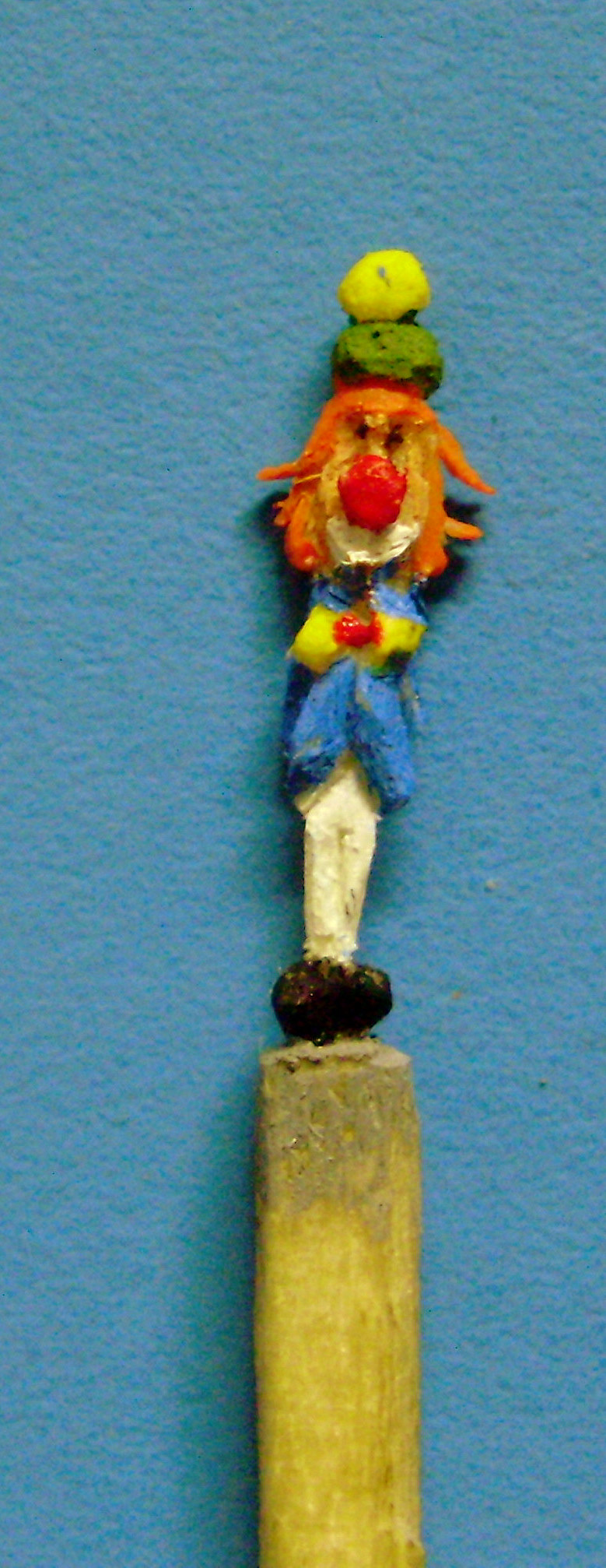 carved clown matchstick