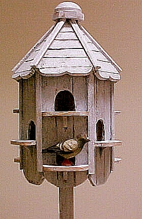 Hand made dovecote with hand carved pigeon